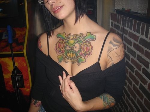 tattoos on girl's chest