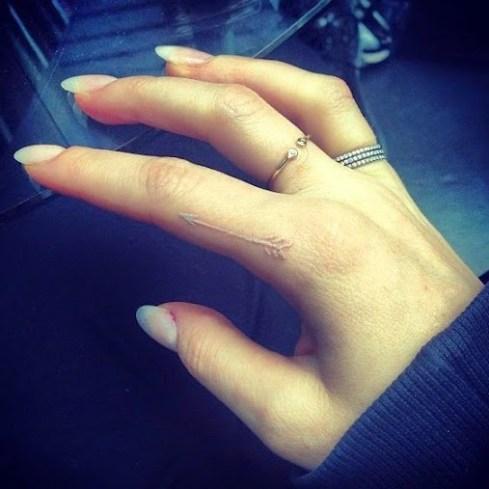 white ink index finger tattoos