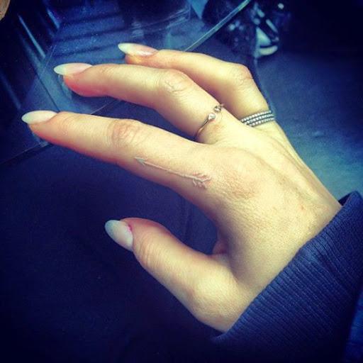 Arrow tattoos white ink on finger