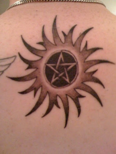 tribal sun tattoos