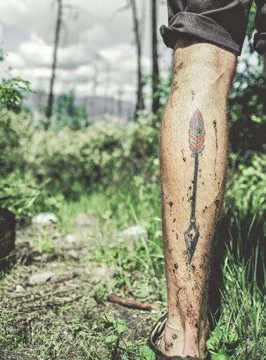 Arrow tattoos on leg