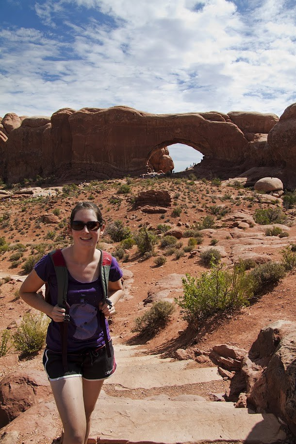 Renee infront of Cove Arch - Arches National Park.jpg