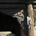 wood carvings under the eaves of a gatehouse.JPG