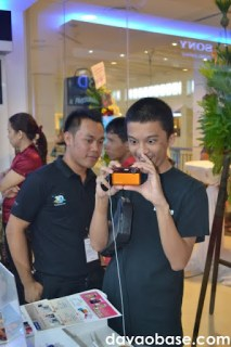 Mindanao Times writer Jesse Pizarro Boga in awe of the orange Sony Cybershot digital camera at Sony Centre in Abreeza Mall