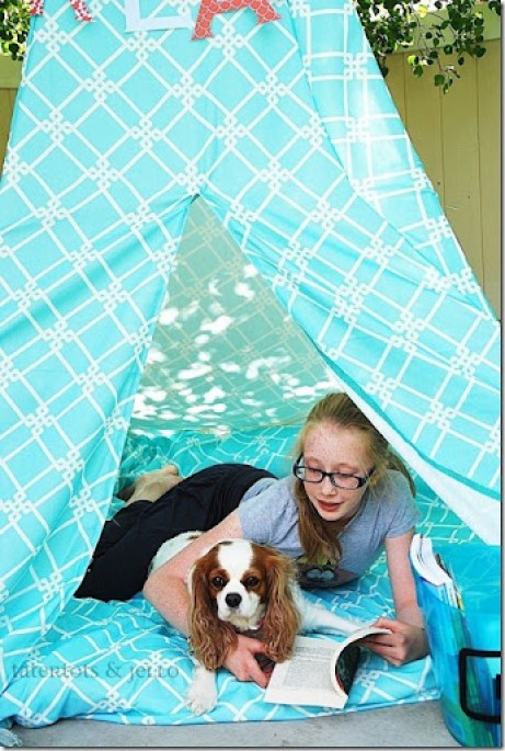hannah and trixie in the reading teepee