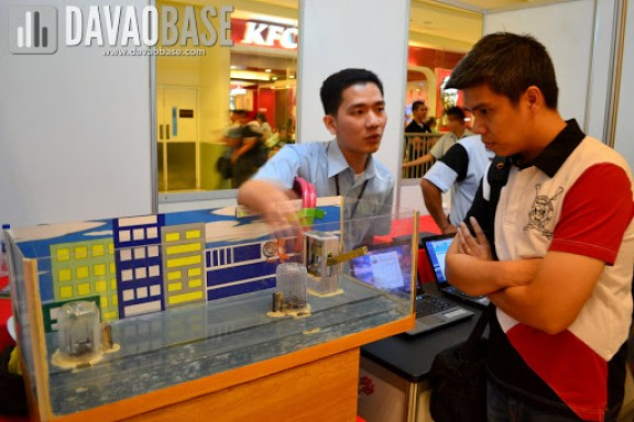 A Computer Engineering student explains their project during AdDU-CEA Technical Exhibit at Abreeza Mall