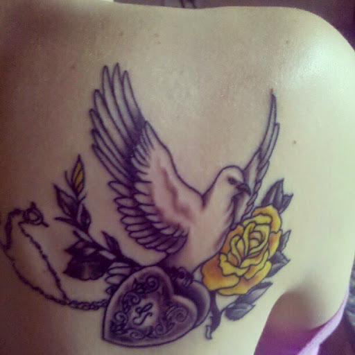 50 cute and lovely dove tattoos for men and women for Dove and rose tattoo