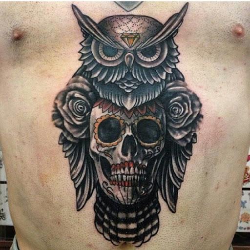 owl tattoo design on chest with sugar skull tattoo design