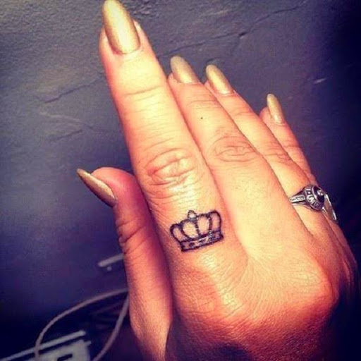 small crown tattoos on finger