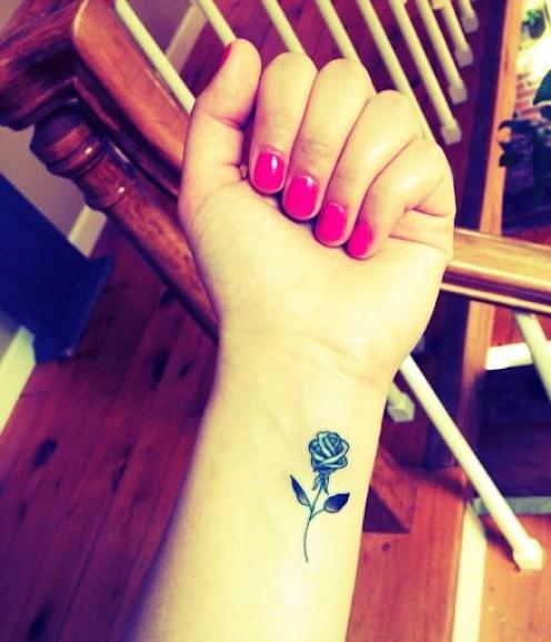 small rose tattoos on wrist
