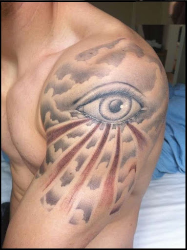 Cloud tattoo with eye on shoulder