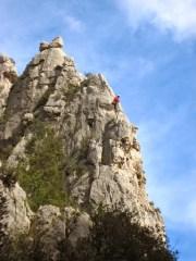 Climber above Calanque d'en Vau