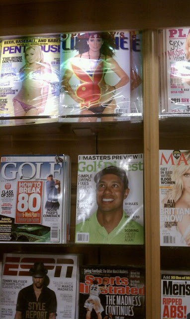Tiger Woods magazine cover looking up at Adult magazines