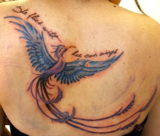 Phoenix tattoo on back opf girls