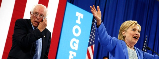 Democratic presidential candidate Hillary Clinton, accompanied by Sen. Bernie Sanders, I-Vt., speaks at a rally in Portsmouth, N.H., Tuesday, July 12, 2016, after Sanders introduced her and endorsed her for president. (AP Photo/Andrew Harnik) ORG XMIT: NHAH210