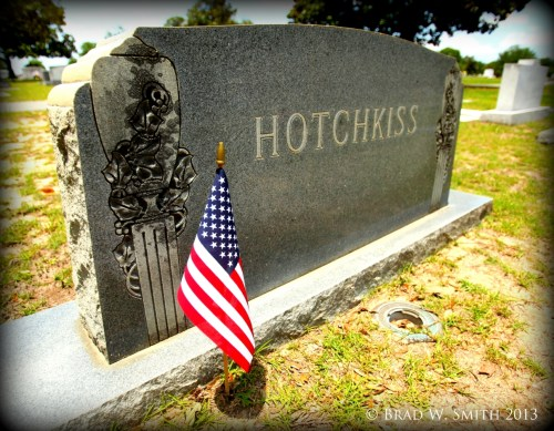 granite cemetery headstone with American flag