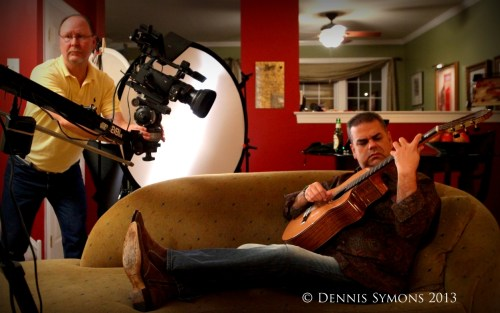 Musician Arturo Romay playing guitar during a music video shoot.
