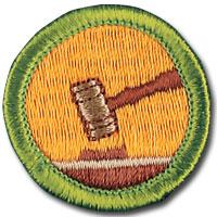 round badge showing gavel striking a sound block