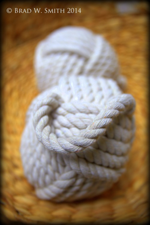 2 rigging ropes, each formed into a knotted ball and tied to form a weight.