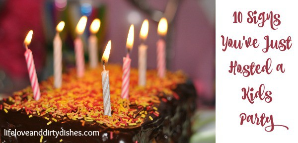 Birthday cake with the taxt 10 signs you've just hosted a kids party