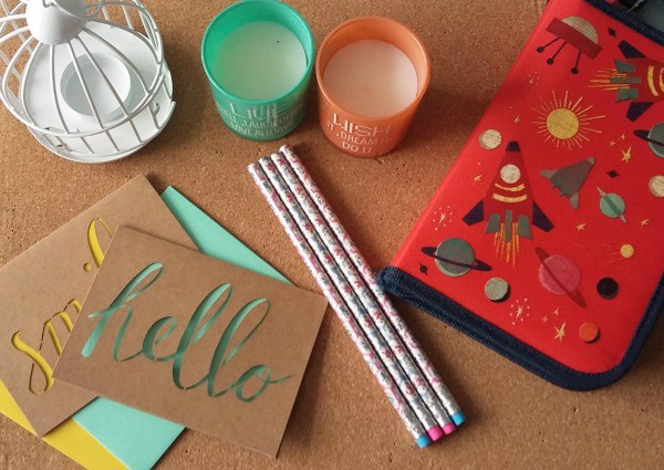 Image of candles, pencils and notecards all 5 under £5