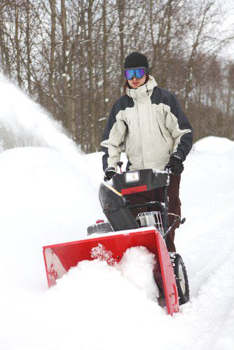 Man with snow thrower