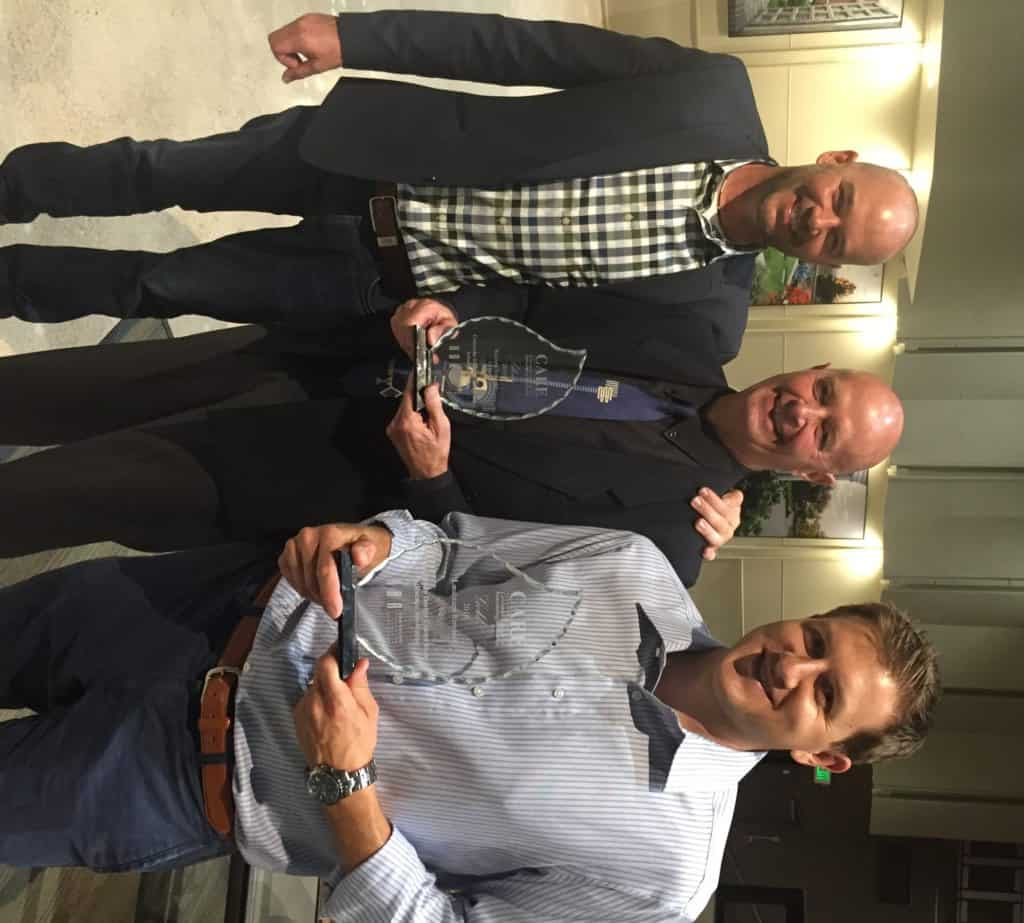 Dan DeGrush right and John Buchanan with Colorado Design Consortium won a CARE Award from HBA for Landscape Remodel.