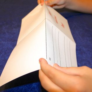 Shows the Valentine's Day blank card being folded in half with the top going behind the bottom.