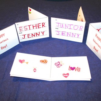 Show several finished homemade valentine's day cards.