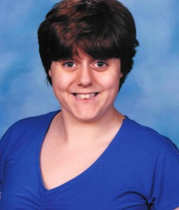 Image shows teenage girl in blue shirt