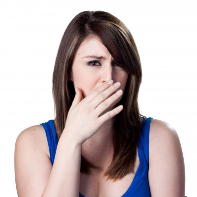A photo of a woman covering her nose after a bad fishy smell