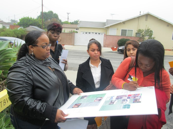 LAFA|Dorsey students sign their marketing campaign mock-up for Community Build.
