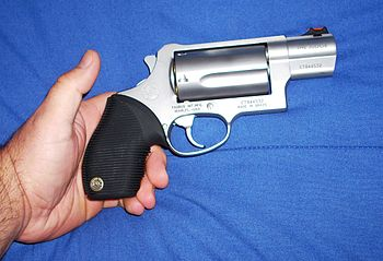 English: Taurus Public Defender revolver, cham...