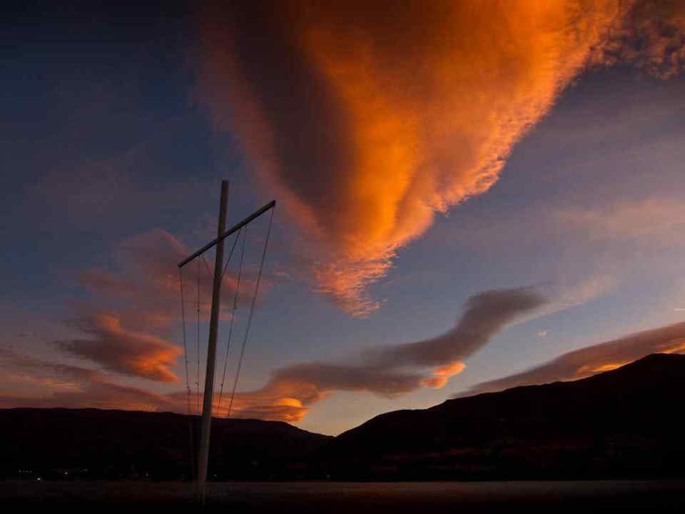 Wanaka Sunset with Cross and Cloud by Donald Lousley.