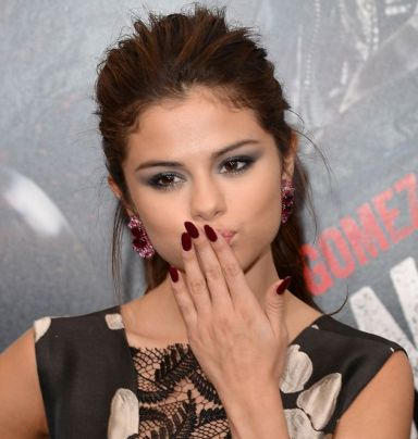 WESTWOOD, CA - AUGUST 26: Actress/singer Selena Gomez attends the premiere of 'Getaway' presented by Warner Bros. Pictures at Regency Village Theatre on August 26, 2013 in Westwood, California. (Photo by Jason Merritt/Getty Images)