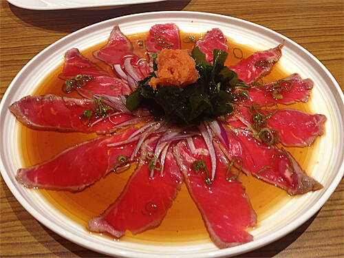 Beef tataki (thinly sliced Alberta AAA streak, seared and garnished with daikon radish, onions and served with citrus ponzu sauce, $12) at Sakai Sushi Bar in Spruce Grove!