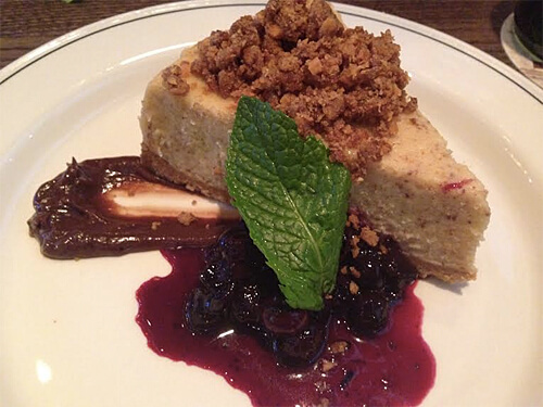 Butterfinger Cheesecake - Graham Cracker Streusel, Blueberry Compote ($9)