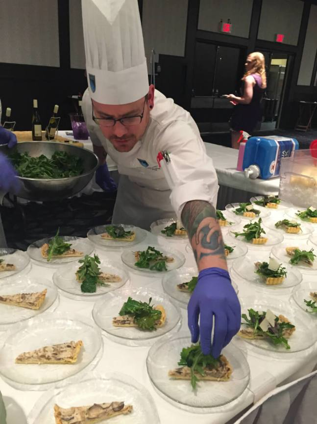 Joshua Ward with NAIT's School of Hospitality and Culinary Arts puts the finishing touches on their Cheesiry Fresco Tart.