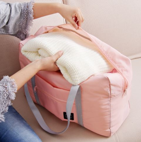 Reisebag til koffert lys rosa miljøbilde woweffekt