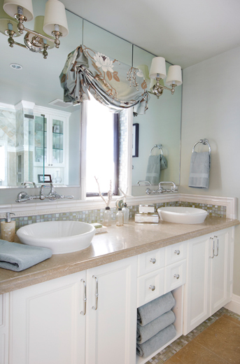 Beachfront master bathroom interior design features clean whites and sinks that come out of the mirror