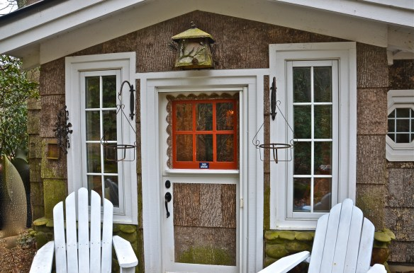 The Dutch door is Poplar bark trimmed with red–the white trim is simple and clean