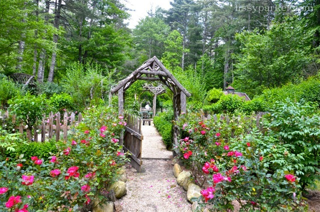 Locust and rhododendron gate and arbor welcome all to enjoy at the front axis