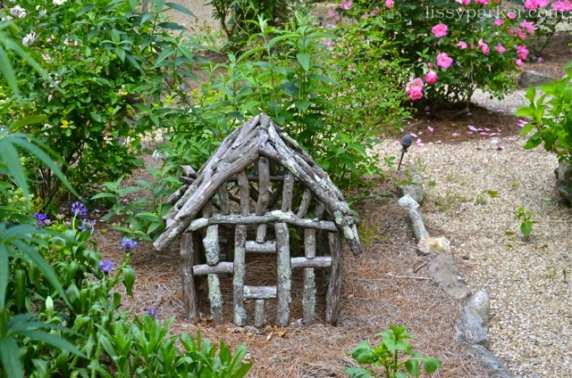 Small cat or dog resting area is near the gazebo—lucky pet