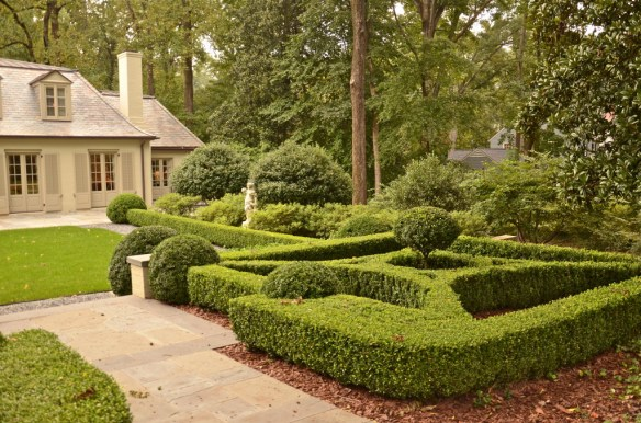 Boxwood entry garden—there is a creek just beyond this garden