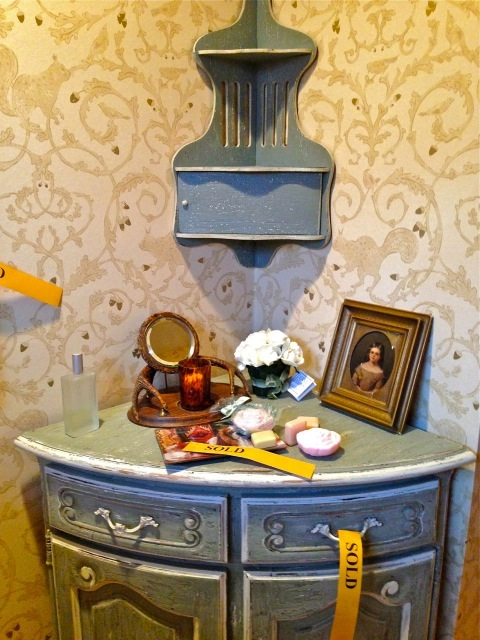 This small chest is also in the half bath—love this blue and the squirrel wallpaper. He used this paper often