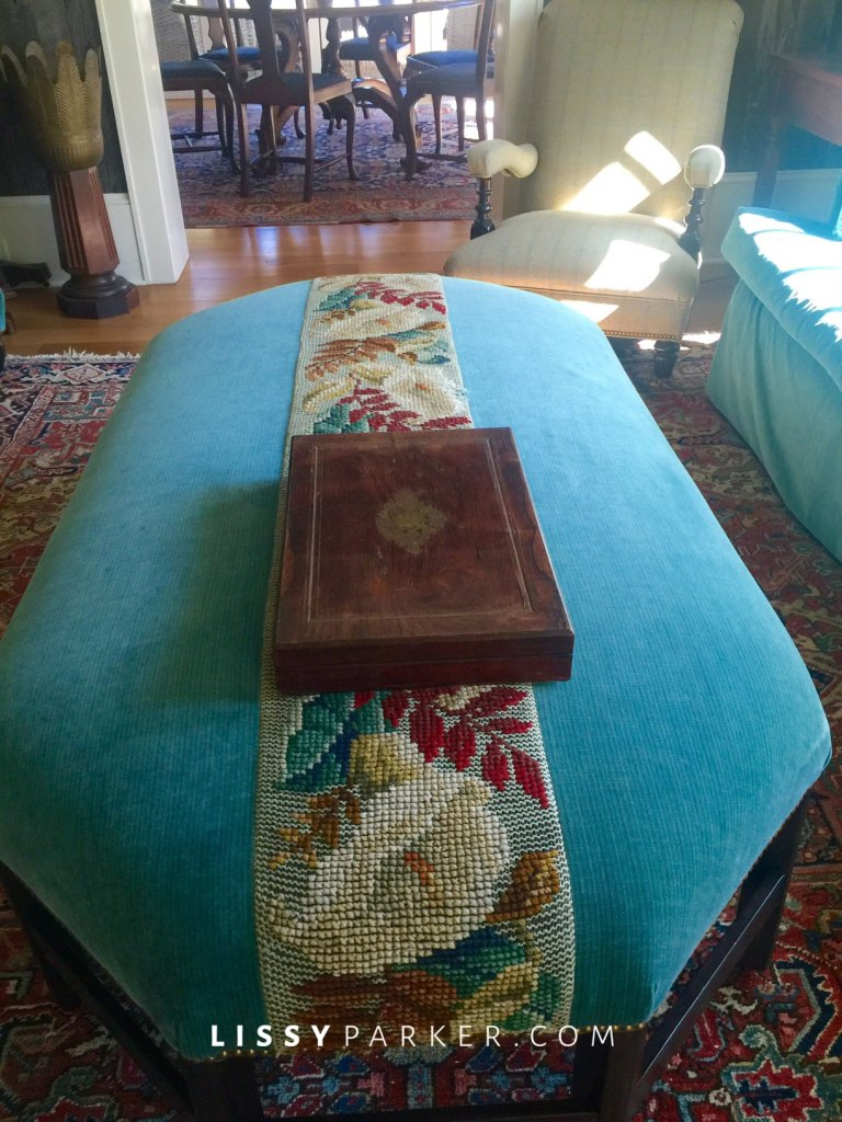 Beautiful large ottoman is striped with Portuguese needlepoint