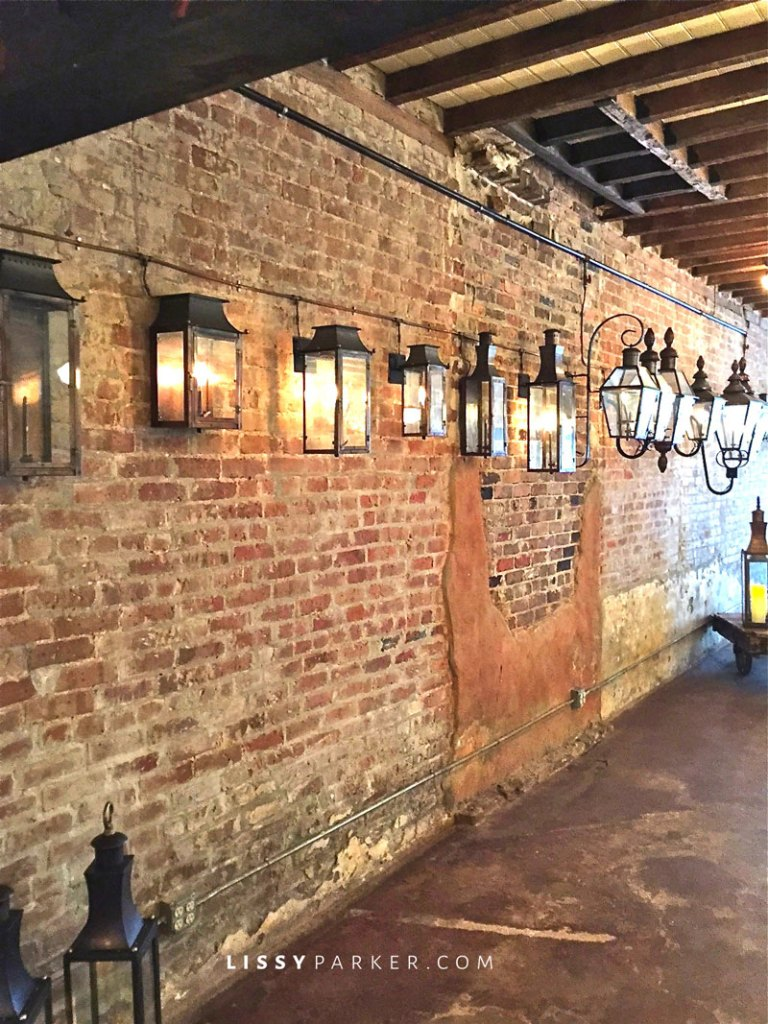 copper lanterns on a brick wall