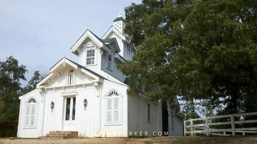 white Victorian horse barn