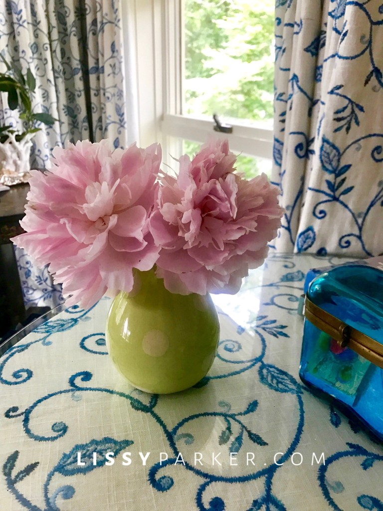 pink peonies on the table