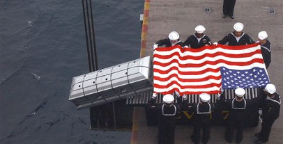 1280px-US_Navy_040214-N-7986B-071_A_U.S._Navy_Commander_is_committed_to_the_sea_during_a_burial_at_sea_ceremony